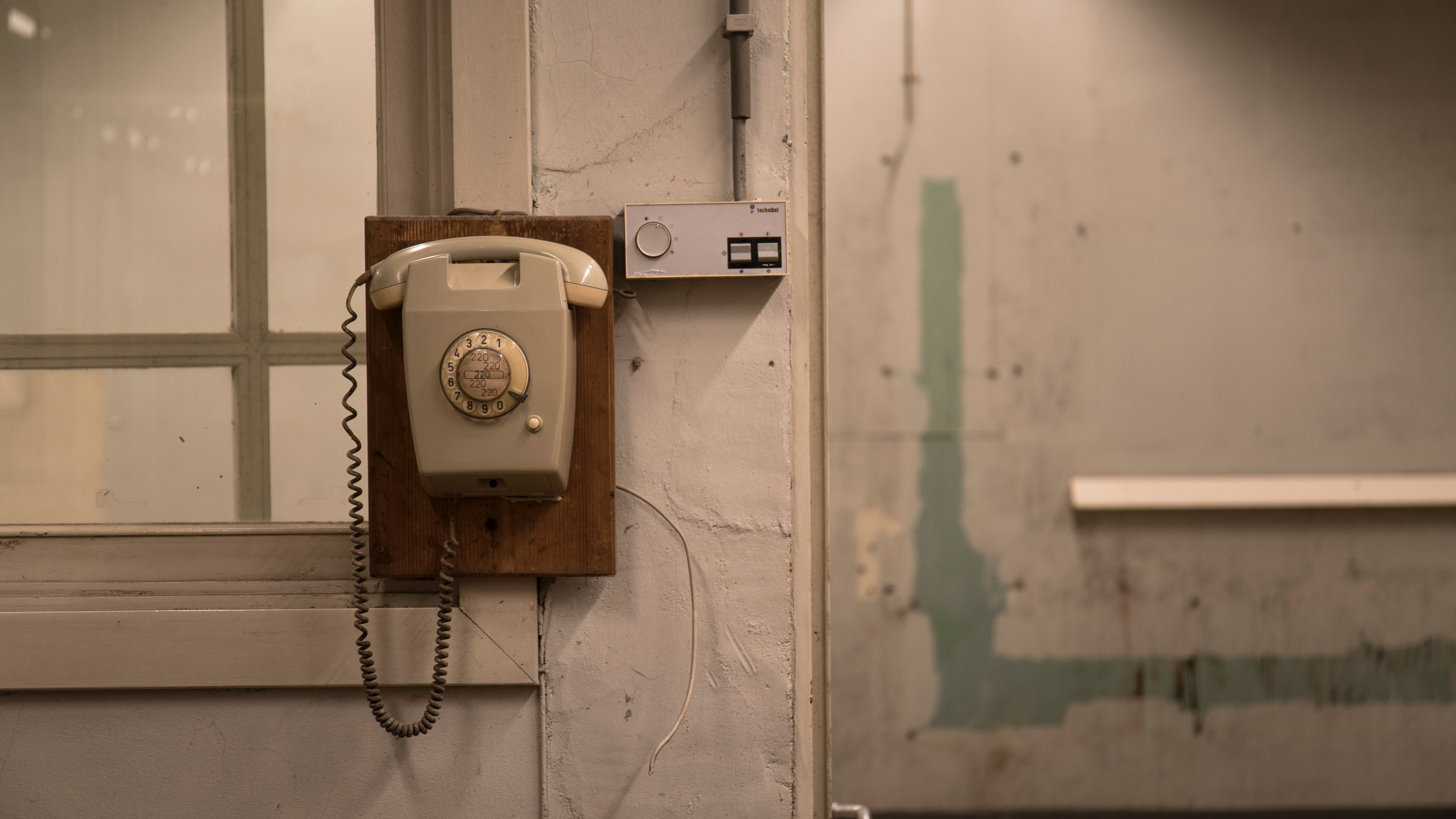 80s telephone on a wall contact us